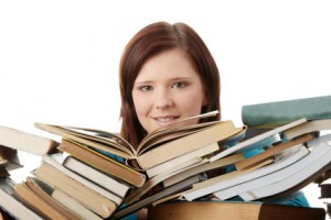 Young woman behind books